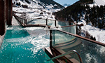 Relaxing outdoor jacuzzi with ski slopes views